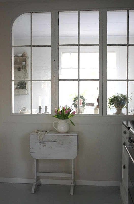 interior windows. Love them. Good way to share light if you can't knock down a wall, or want to create a divide between 2 rooms.