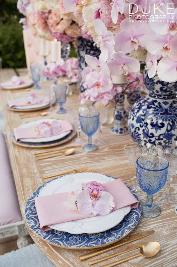 Tablescape ~ Pink napkins with blue and white plates                                                                                                                                                     More