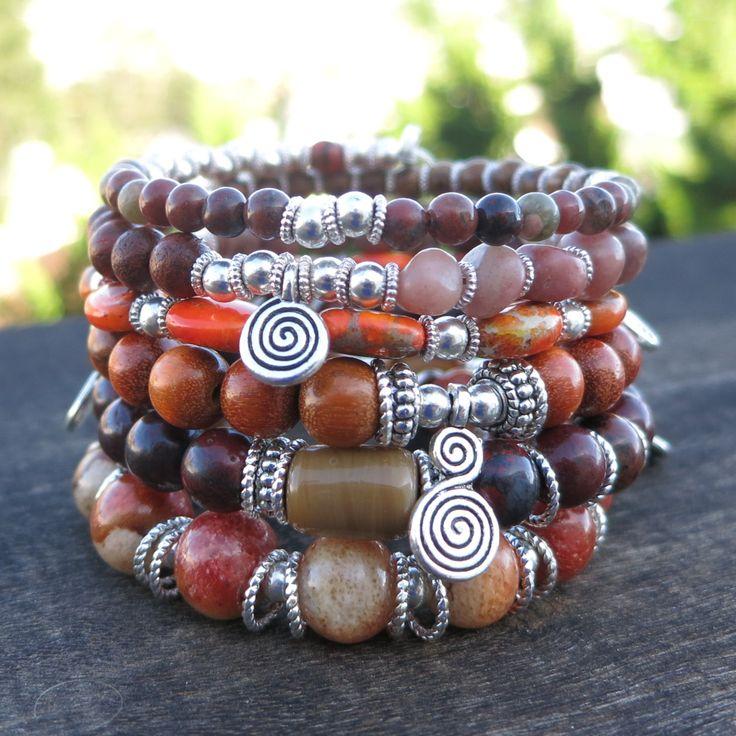 Fait avec des Philippines Apple corail, jaspe rouge, oursin de mer, Sibucao Wood, Rose Rhodochrosite, jaspe Orange et perles en argent tibétains. Comprend plusieurs breloques en calebasse argenté tibétain Antique tourbillon. Dimensions: environ 6 boucles; les perles sont de 2-9mm; Breloques sont 12-18mm de long (6 au total)  ** En argent et Antique argent perles ont sans plomb, nickel ni cadmium.  ** Bracelets fil mémoire sont souples et sadapter à tous les poignets.  Sur fil mémoire…