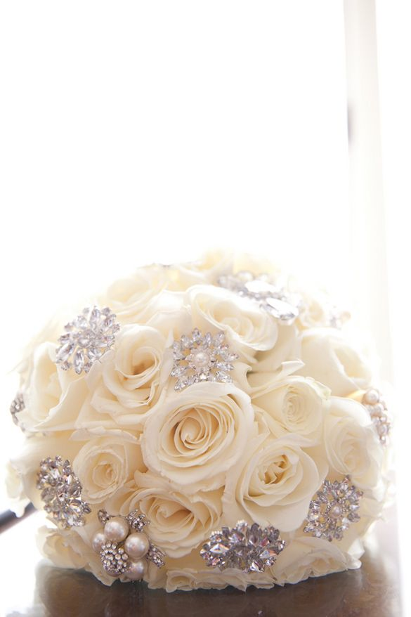 White rose bouquet with antique brooches