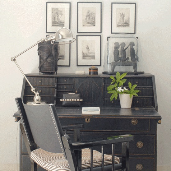 Colonial-style home office  Create an inspiring setting with a Colonial-style bureau and team it with a similar style of chair. A formal arrangement of prints above thedeskwill add an elegant touch, while plants and ethnic artefacts bring a lived-in feel to the space.