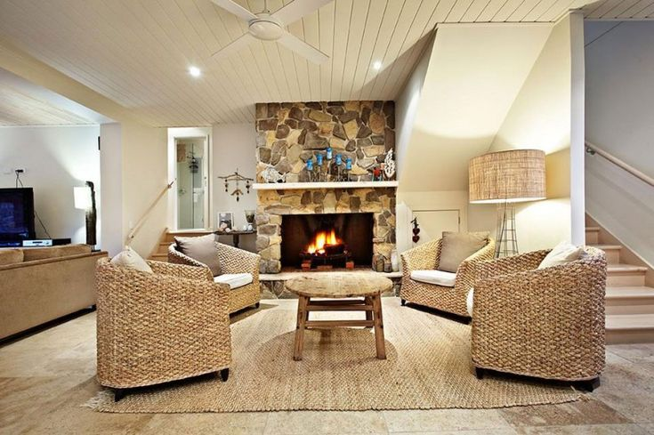 Living Space Inside the Split Level Home in Back Beach with Fireplace Applied…