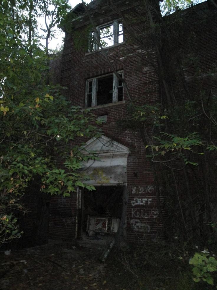 Side entrance of abandoned, crumbling, creepy, and definitely haunted Lambertville High School in Lambertville NJ.