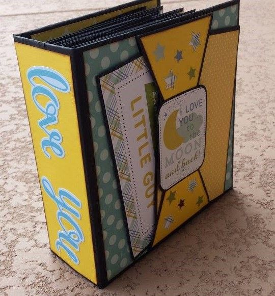 Everyday Life Small Photo Album created by crafter Annette Alexander, using Echo Park, Bundle of Joy paper collection. Click on the link below to purchase the tutorial: http://shop.paperphenomenon.com/Everyday-Life-Small-Photo-Album-Tutorial-tut0137.htm?categoryId=-1 Click on the link below to purchase the tutorial/video combo: http://shop.paperphenomenon.com/Everyday-Life-Small-Photo-Album-Tutorial-and-Video-Combo-tutvid0137.htm?categoryId=-1