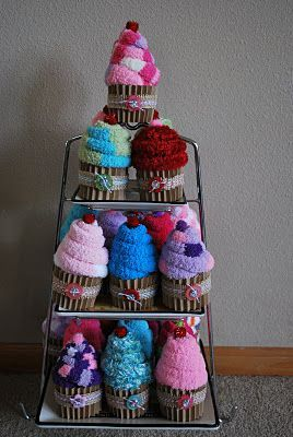 Fuzzy Socks made into cupcakes....awesome slumber party favor. Made these for teacher's gifts but this is a great idea too! Gift basket Ideas #giftbasketideas #giftbaskets