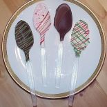 Chocolate-dipped coffee spoons are an easy homemade holiday gift.  Make them simple and sweet or dazzle the tastebuds with custom flavors and colored chocolate melts!  Our basic recipe for chocolate