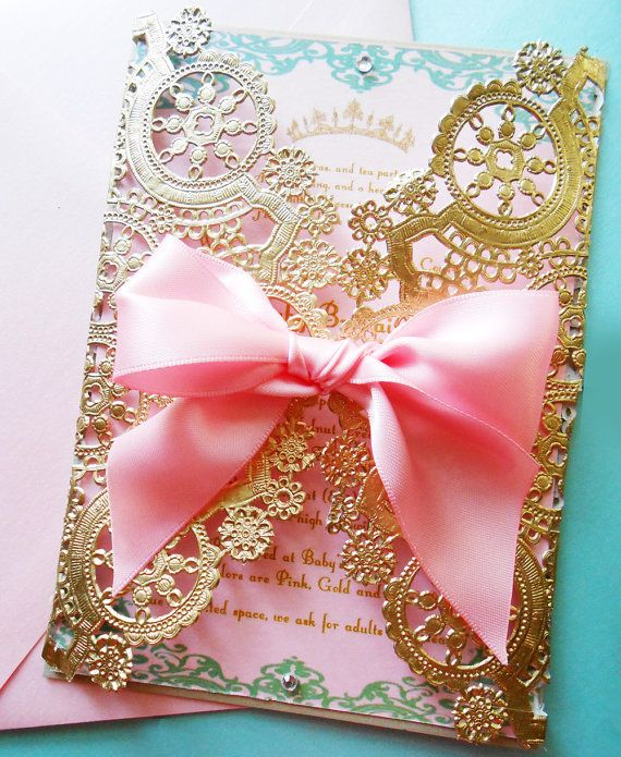 A luxurious laser cut invitation shown here in metallic gold and baby pink for birthdays and baby showers or all white for baptisms and