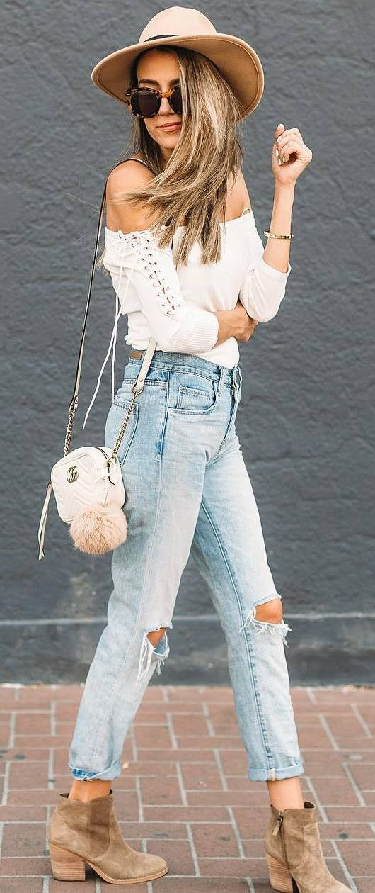 884181a3941b4 trendy outfit idea : hat + white off shoulder top + bag + rips + nude boots