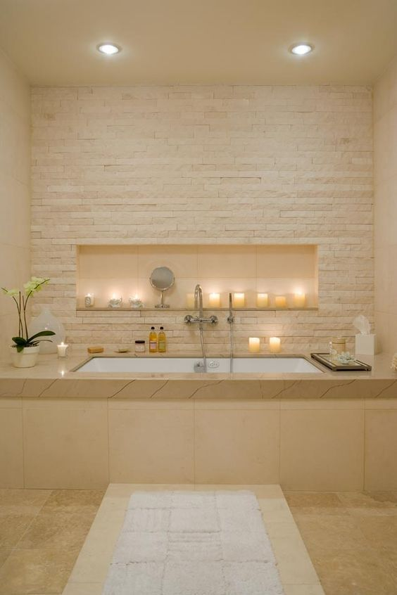 Romantic setting with small bathtub and beige tiles || @pattonmelo