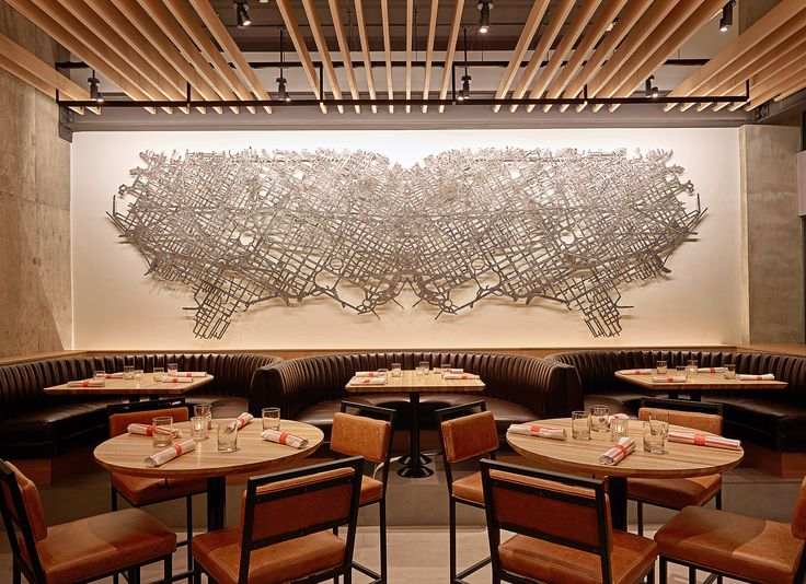 Ricky Alvarez, 2015 // Earls Tysons Corner, Virginia // This cartographic sculpture is a representation of the unique grid work and intersecting lines that form the main streets of Washington, D.C.  As it projects off the wall, shadows play with the viewer's depth of field and duplicate the symmetrical patterns. The dynamic texture comes from pouring molten pewter into open-faced sand casted molds creating unique segments which are interlocked to form the final piece.