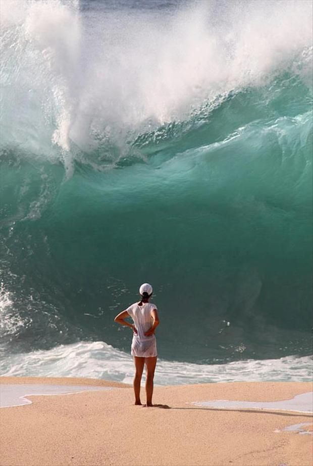 65 Pictures of the Day~~some very cool images!  I'm saying she wouldn't be standing there if that was a wave fixing to hit shore!