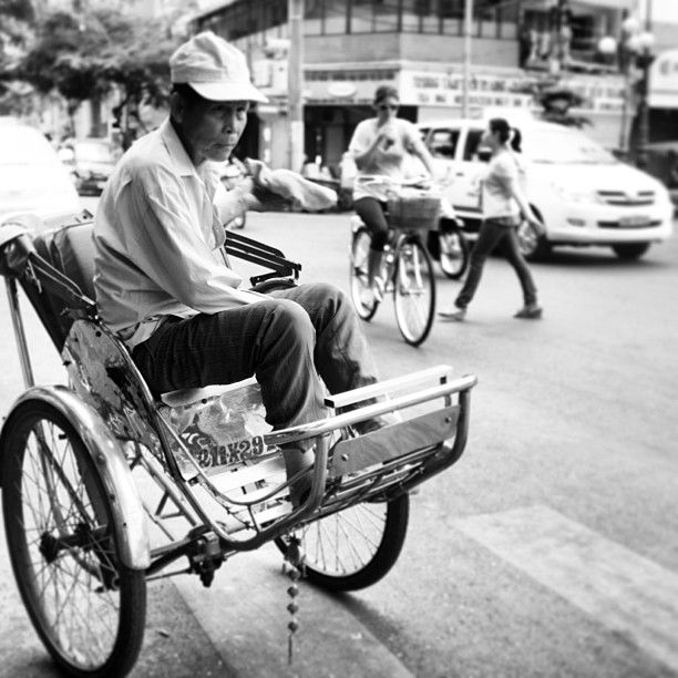 Waiting for customer. Old man, one side of Saigon City, Vietnam