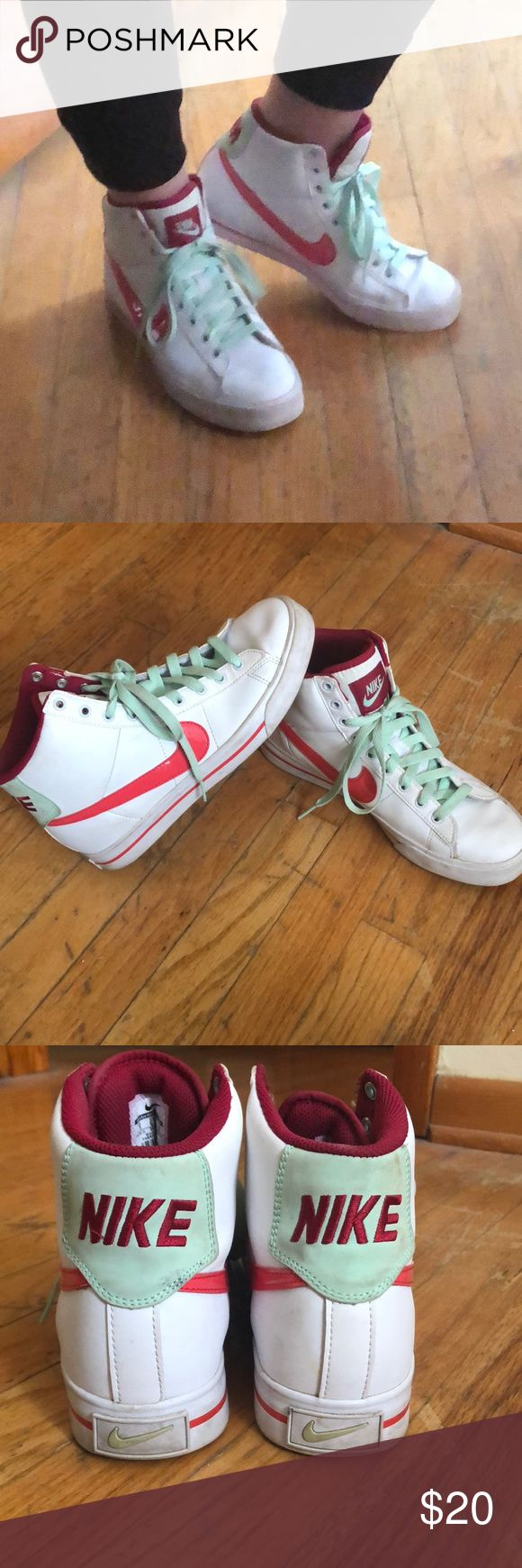 Vintage Nike Hi-Tops Super cool old school looking Nike Hi-Tops. Unique colors. White burgundy, coral, and light green for the laces. Few signs of wear. The tag says a US size 9. I am a size 8 1/2 and these fit great! Shoes Sneakers