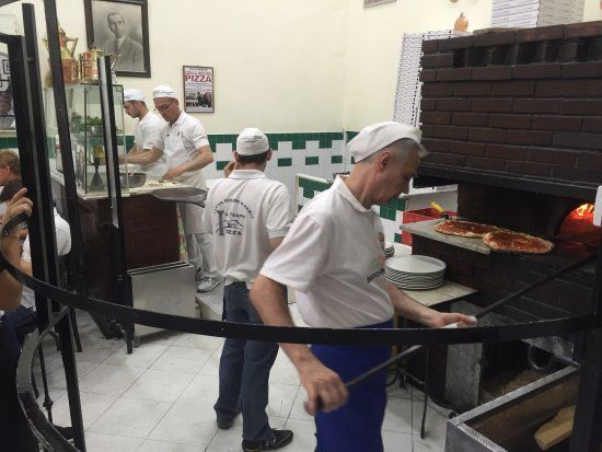 """Napoli in un Pin: L'Antica Pizzeria da Michele, opened in 1870 in the heart of the city, is defined by experts and journalists as """"the Sacred Temple of Pizza""""."""