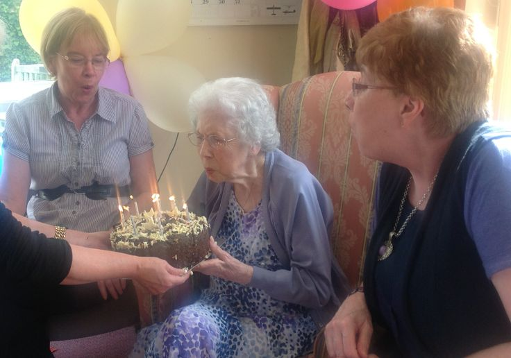 Nellie & her daughters, Christine & Barbara helped Nellie to blow out all the candles on her Birthday cake at her Birthday party at Birch Green Care Home, happy birthday Nellie x