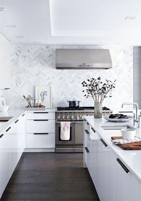 White kitchen with herringbone blacksplash
