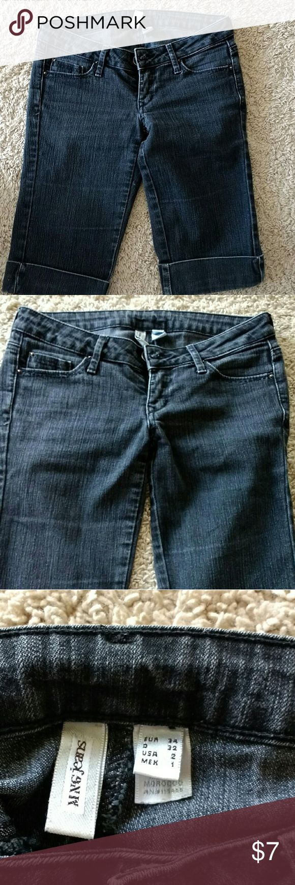 Black faded MNG jeans shorts size 0 Black faded jeans shorts Brand Mango Jeans Size stated US 2 but fits smaller - US 0 No stains, holes or discoloration Knee length skinny shorts Mango Shorts Jean Shorts