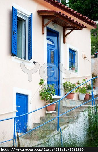 Traditional Greek houses with stair case and blue painted
