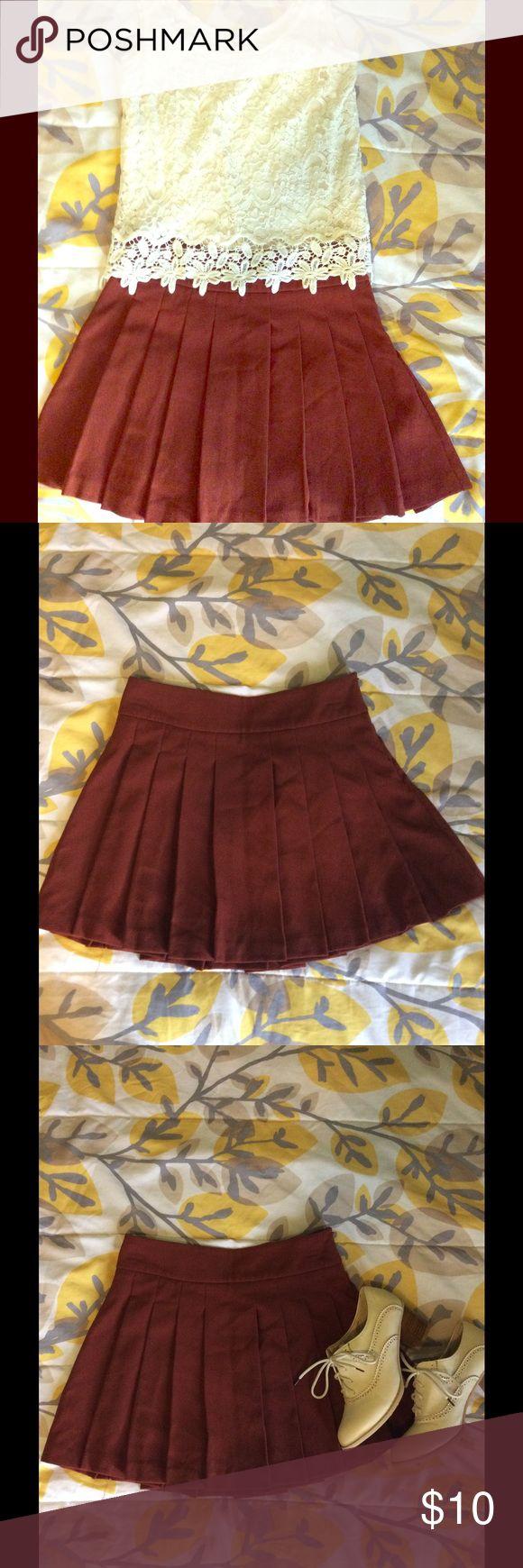 Forever 21 Rust Colored Mini Skirt Lightly worn, schoolgirl style rust/maroon colored mini skirt. Forever 21 Skirts Mini