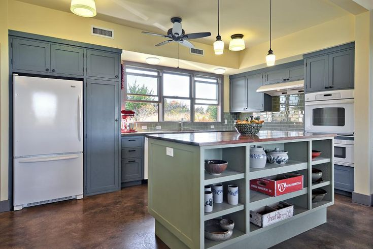 Dusty blue cabinets and a sage green kitchen island for Sage green kitchen cabinets with white appliances