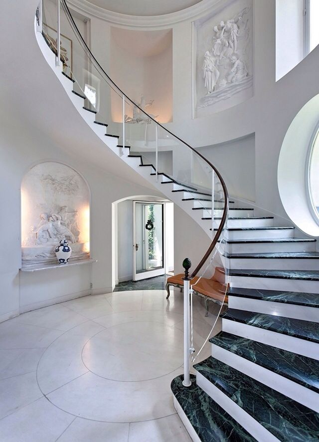 Luxury mansions interiors foyer at the top of the for House plans with stairs in foyer