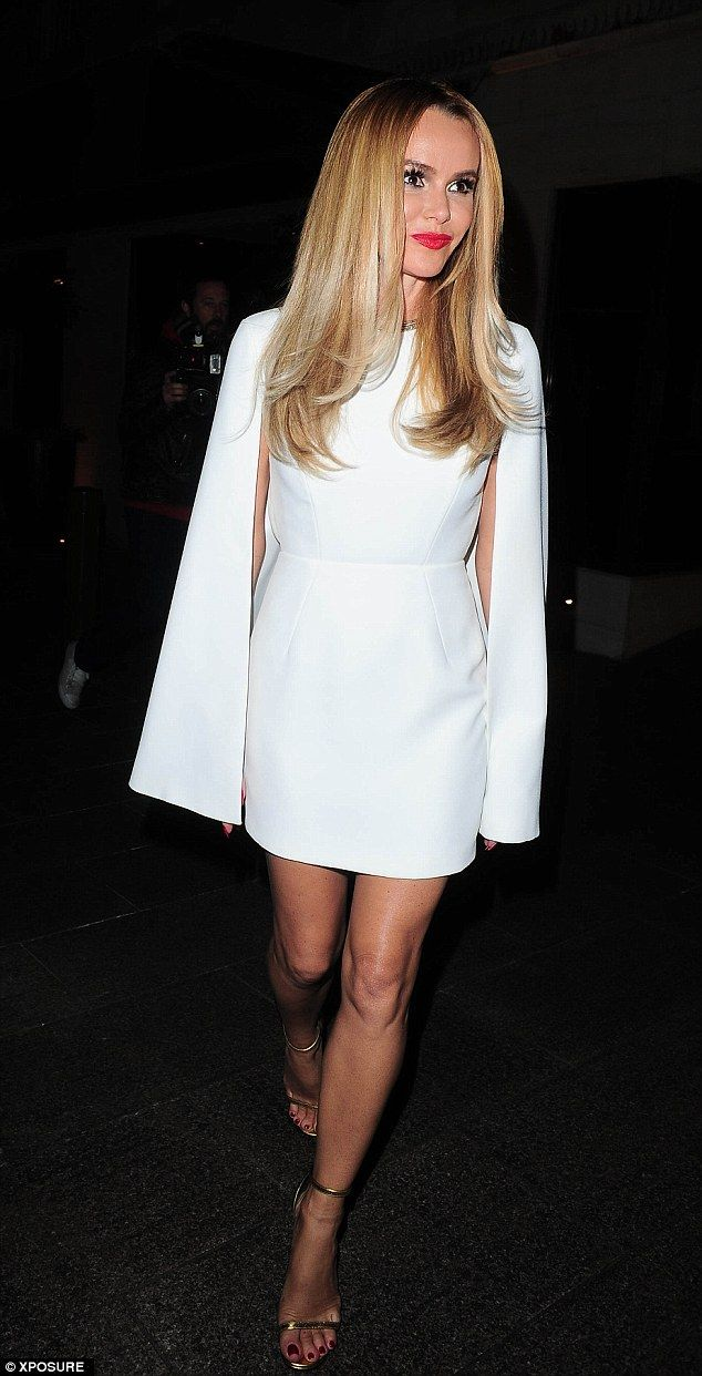 Turning heads: The 44-year-old managed to look sensational as she covered up her famous as...