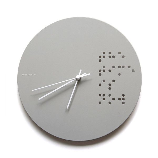 'The time is now' written in Braille - a modern graphic witha message Powder coated steel plate in Taupe colour 300mm diameter Silent sweep clock mechanism Whi
