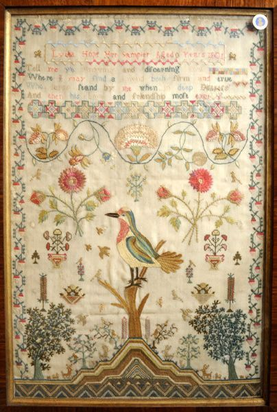 Antique sampler stitched by Lydia Hope in 1801. A hand from the past touches the present.
