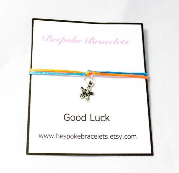 A simple good luck charm bracelet that is carefully handmade by me and is perfect as a little bracelet gift to wish someone good luck! It is made using macrame knots with satin cord and has a beautiful little flower pendent charm in the middle, dangling down on a jump ring. The bracelets is adjustable and comes on the card. Sizes > If you would like the bracelet bigger or smaller than the average size please include this in the note to seller at checkout, if you do not include a request then…