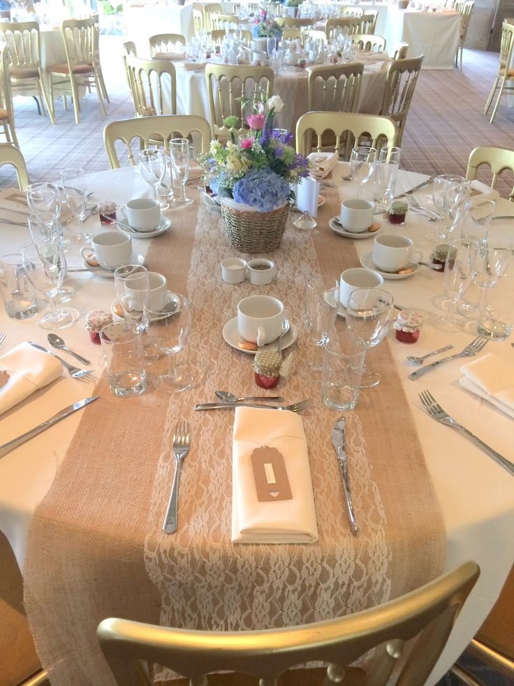 Simple country chic table display, great idea to use the hessian as a table runner