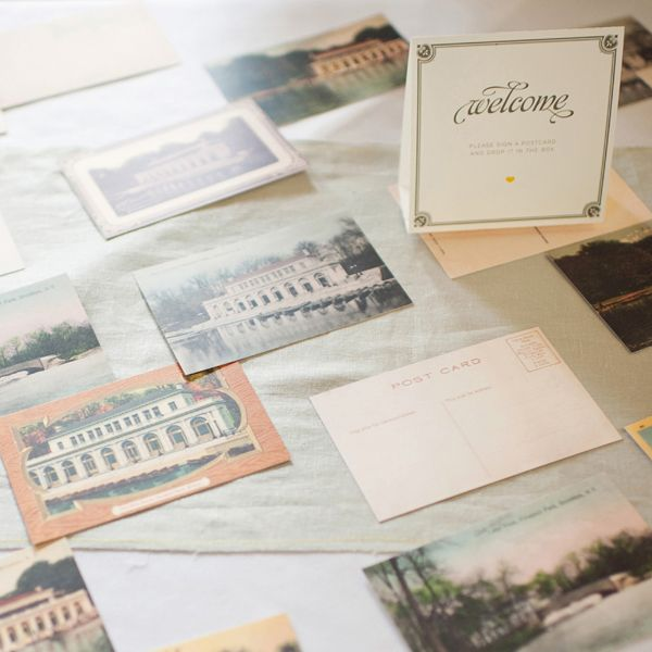 Guest book inspiration:  Leave postcards for your guests to write a note, have your maid of honor mail to you while on your honeymoon! Photo: Oh, Darling!