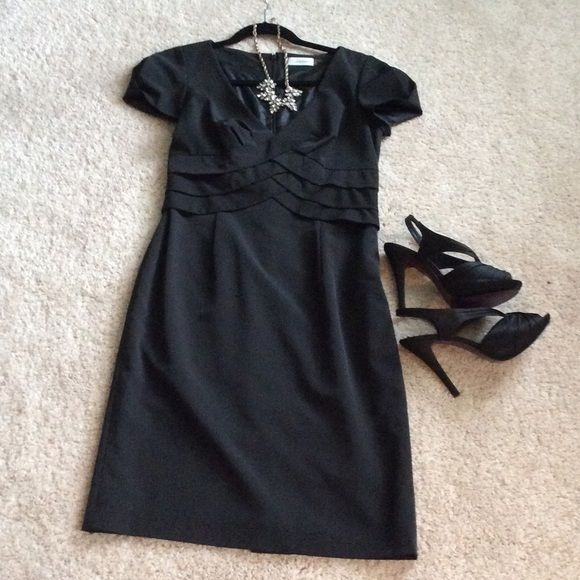 BLIZZARD SALE❄️❗️Gorgeous LBD from Calvin Klein Beautiful black dress worn only once! Gorgeous details with weave on front and back buttons. Deep V neckline. A must have for every wardrobe! Calvin Klein Dresses