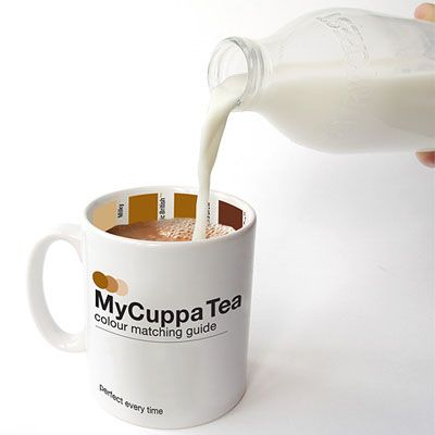 A tea or coffee cup printed with a color matching guide to help people add just the right amount of cream by matching the color of the liquid mixture.