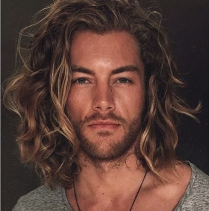 guy long wavy brown hairstyle man model