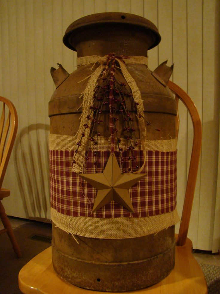 Decorated an old rusty milk can from the antique store...we have lots of these old cans and <3 <3 <3 that they can look great with a bit of burlap and gingham...