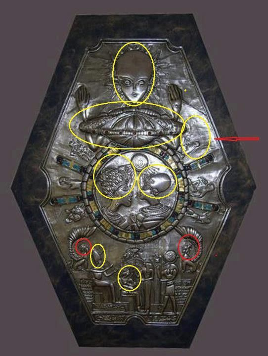 "Medallion found in ancient Egyptian tomb.The Egyptian pharoahs have elongated skulls, as found in Paracas. Some figures have ""alien like"" features.  One theory is that an ""alien like"" being and a possible space craft are at the top to represent alien rule /leadership over the Egyptians in ancient times."