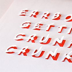 Make wall art from funny pop song lyrics using cut-paper lettering
