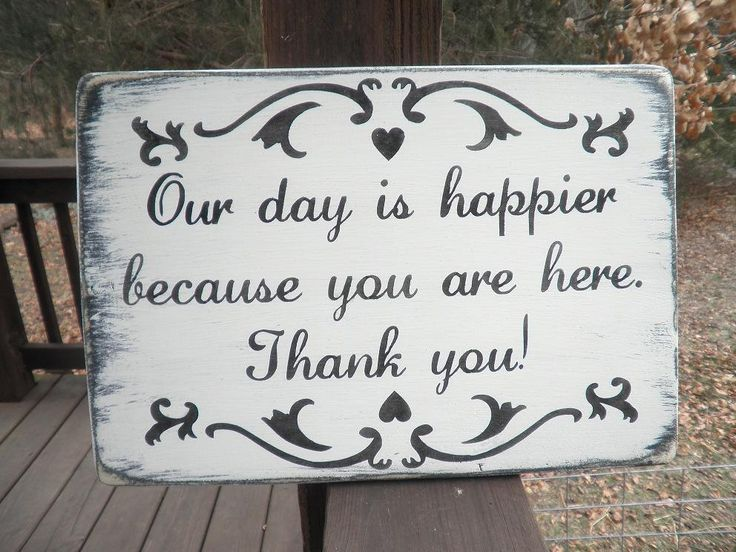 "Wedding sign, ""Our day is happier because you are here Thank You""  white distressed with black.. $23.00, via Etsy."