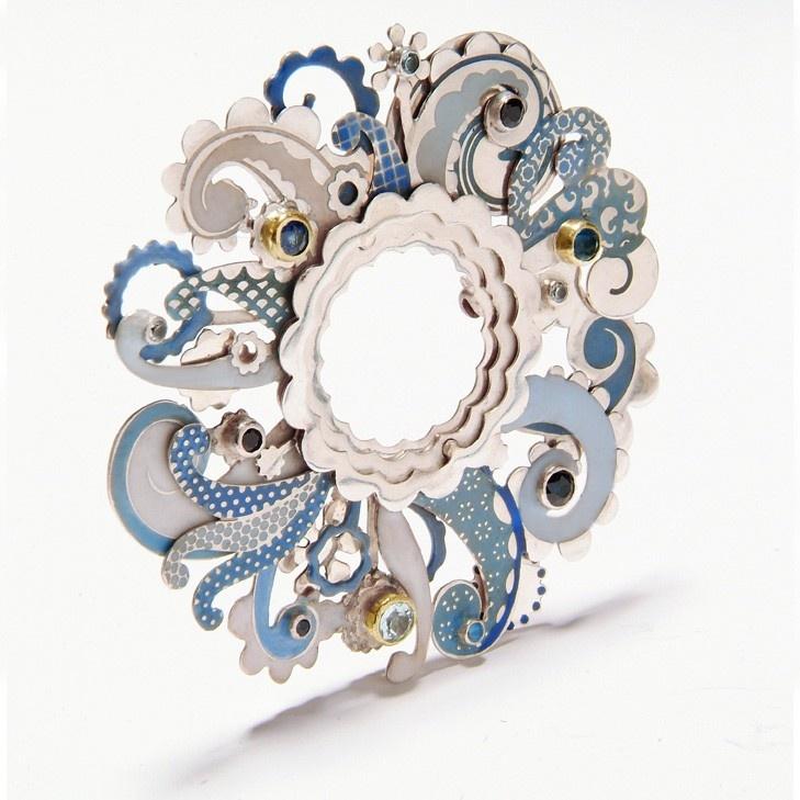Brooch | Barbara Macleod. 'Swirl'. Sterling silver, enamel, sapphire, aquamarine, topaz and 18k gold.