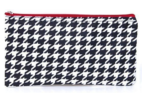 """Houndstooth Red Trim Cosmetic Flat Makeup Bag by Private Label. $6.85. Color: Black White Red. Zipper main enclosure. Multipurpose accessory bag for cosmetic, brushes etc.. Material: Microfiber. 10"""" wide x 5.75"""" tall. Get organized with this multipurpose makeup bag to store brushes, eye shadows, lipsticks, and your other supplies for your beauty regimen. Use it for toiletries for traveling or keep your skincare essentials easy to grab and go to the gym.  Compact enough to slip ..."""