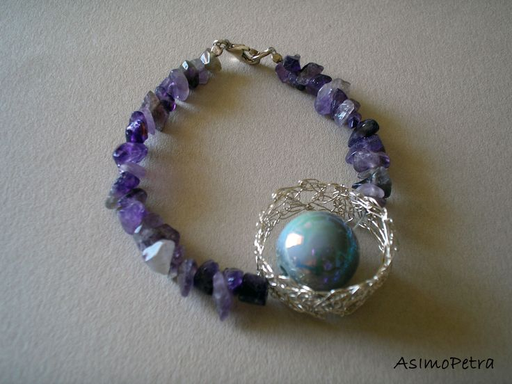 This handmade bracelet is made of amethyst, ceramic bead and hand knotted 950 silver wire.