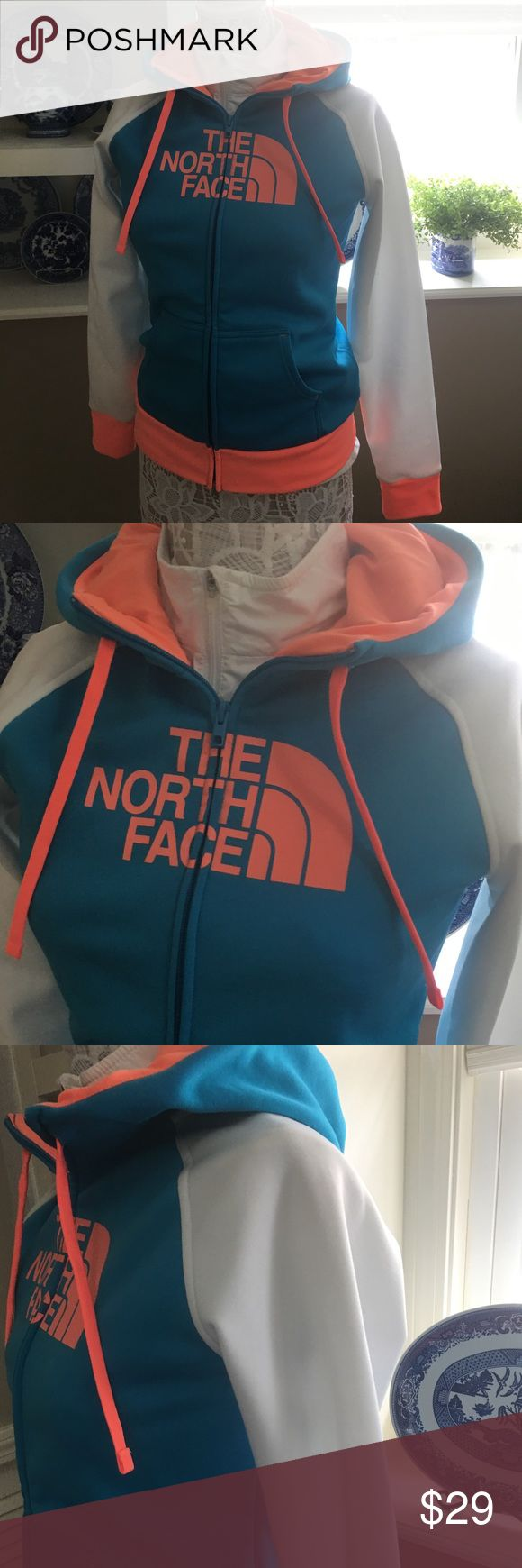 """The NORTH FACE Fleece Lined ZIP UP HOODIE This hoodie is an awesome performance piece and is always a show stopper! The few times I have worn it, I get a lot of compliments 😊 The neon colors against the white really make it pop! In EUC. Approximately 24""""L, 25"""" sleeves, zips to neck and includes drawstring at neck as well, functional front pockets and a lined hood. Comes from a smoke free home 🏡 Bundle & save! The North Face Tops Sweatshirts & Hoodies"""