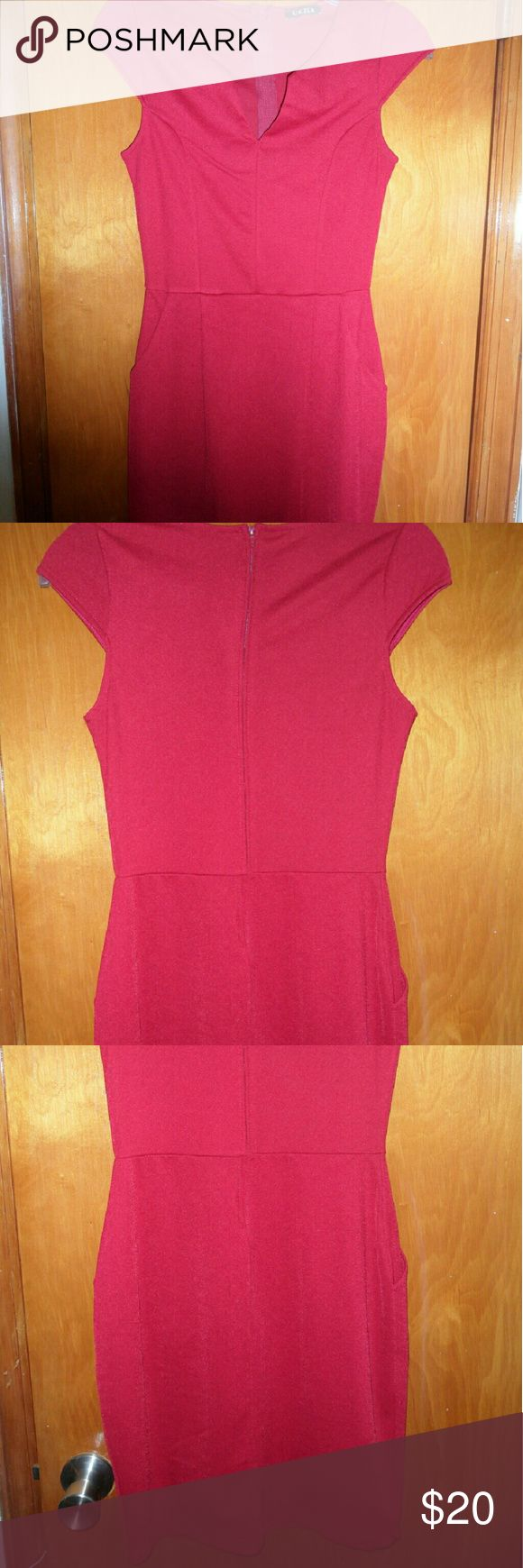 UK 2 LA Red Midi Dress with Pockets Beautiful red dress from UK2LA with curving v-neck. Falls right below the knee. 2 front pockets, Size small. Perfect for weddings and showers! UK 2 LA  Dresses Midi