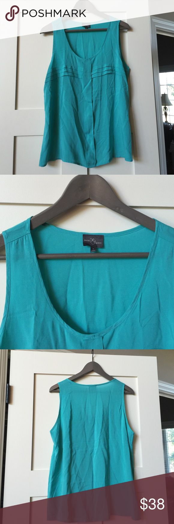 Market & Spruce Stitch Fix szM sleeveless blouse Market & Spruce a Stitch Fix brand SzM turquoise sleeveless blouse.  Has cute front pleating detail.  Would look perfect with skinny jeans and heels or flats.  Comes from free and smoke free home. Market & Spruce a Stitch Fix brand Tops Blouses