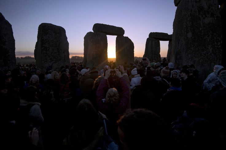 Revelers celebrate the pagan festival of 'Winter Solstice' at Stonehenge in Wiltshire in southern England on December 21, 2012. (BEN STANSALL/AFP/Getty Images)