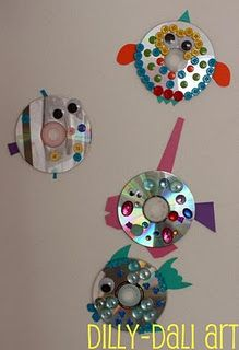 Cute recycled art project for Earth Day   CD Fish www.dillydaliart.com