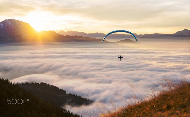 """Flying above the Clouds - A paragliding pilot flying high above a carpet of clouds.  Image available for licensing.  Order prints of my images online, shipping worldwide via  <a href=""""http://www.pixopolitan.net/photographers/oberschneider-christoph-a6030.html"""">Pixopolitan</a> See more of my work here:  <a href=""""http://www.oberschneider.com"""">www.oberschneider.com</a>  Facebook: <a href=""""http://www.facebook.com/Christoph.Oberschneider.Photography"""">Christoph Oberschneider Photography</a…"""