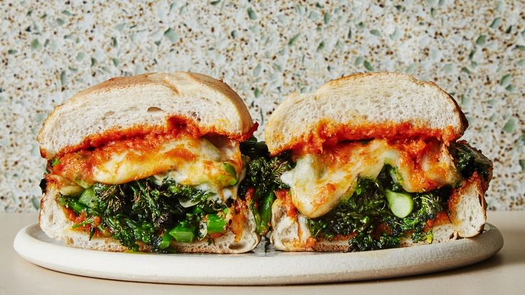 A healthyish take on the classic Philly cheesesteak, these party-ready sandwiches are packed with roasted broccolini, a thick, tangy romesco sauce, and of course, lots of cheese. You've heard it before, and you may not believe us until you've tried them, but you won't miss the meat. This recipe was developed by Rooster Soup Co. in Philadelphia, PA.