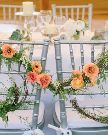 A grapevine-and-flower wreath sweetly joined the bride and groom's chairs together