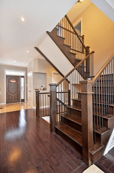 Stair and Railing Ideas | Doyle Homes - For when we update our stair railing.
